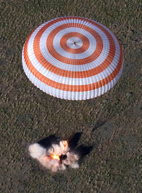. The Russian Soyuz space capsule, carrying U.S. astronaut Tom Marshburn, Russian cosmonaut Roman Romanenko and Canadian astronaut Chris Hadfield, lands some 150 km (90 miles) southeast of the town of Zhezkazgan, in central Kazakhstan May 14, 2013. The first Canadian astronaut to command the International Space Station (ISS) landed safely in Kazakhstan with two crewmates on Tuesday, wrapping up a five-month mission aboard the ISS. REUTERS/Sergei Remezov