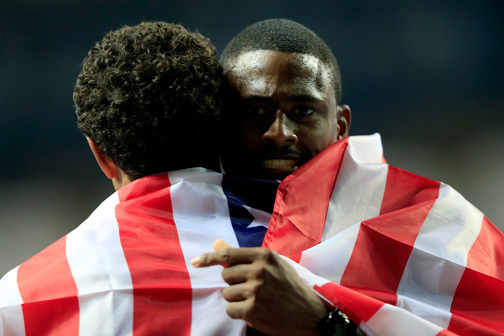 . David Oliver of the United States celebrates winning gold in the Men\'s 110 meters hurdles final with silver medalist Ryan Wilson of United States  during Day Three of the 14th IAAF World Athletics Championships Moscow 2013 at Luzhniki Stadium on August 12, 2013 in Moscow, Russia.  (Photo by Jamie Squire/Getty Images)