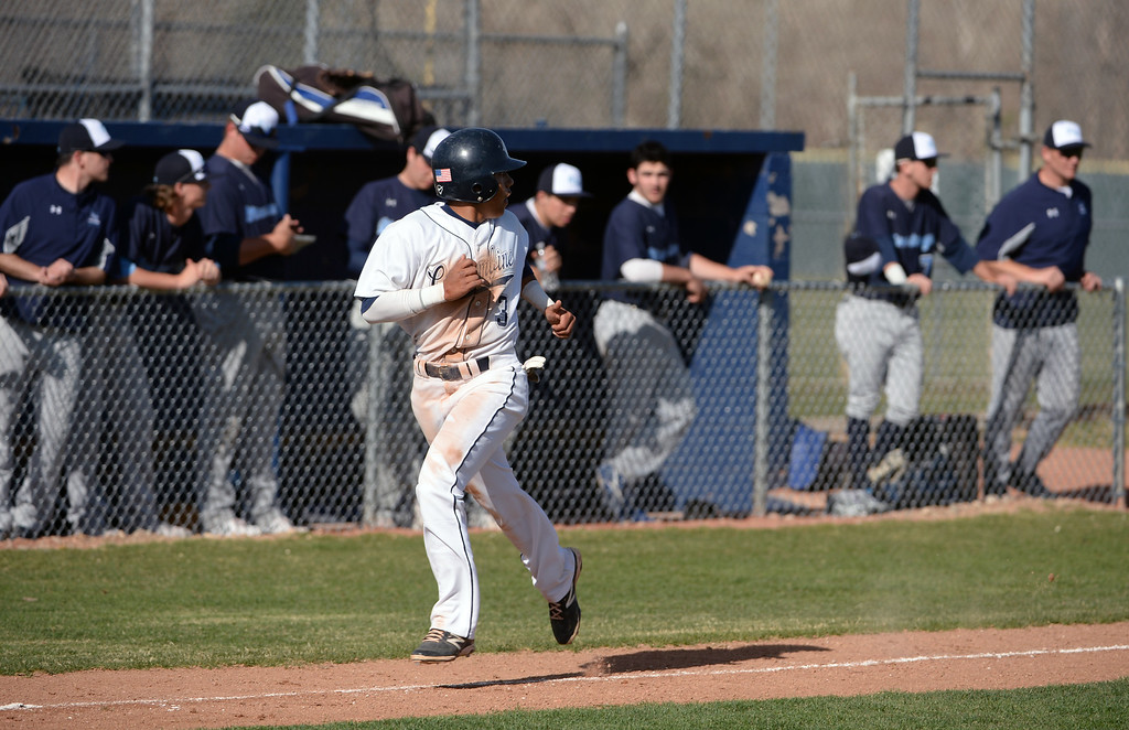 . LITTLETON, CO - APRIL 16,  2014: Columbine Rebels Donny Ortiz, #3, looks back as he races towards home after hitting a home run in the fourth inning in their game against the Ralston Valley Mustangs at Columbine High School in Littleton, Co on April 17, 2014. Columbine pitcher Blake Weiman had a great game and was taken out in the fifth inning when the Rebels were up 8 to 1 over the Mustangs. (Photo By Helen H. Richardson/ The Denver Post)