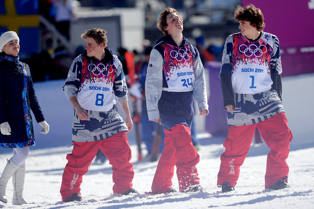 . U.S.A. medalists from left to right, Gus Kenworthy (silver), Joss Christensen (gold) and Nick Goepper (bronze) walk to the podium after the men\'s ski slopestyle final at the Rosa Khutor Extreme Park. Sochi 2014 Winter Olympics on Thursday, February 13, 2014. (Photo by AAron Ontiveroz/The Denver Post)