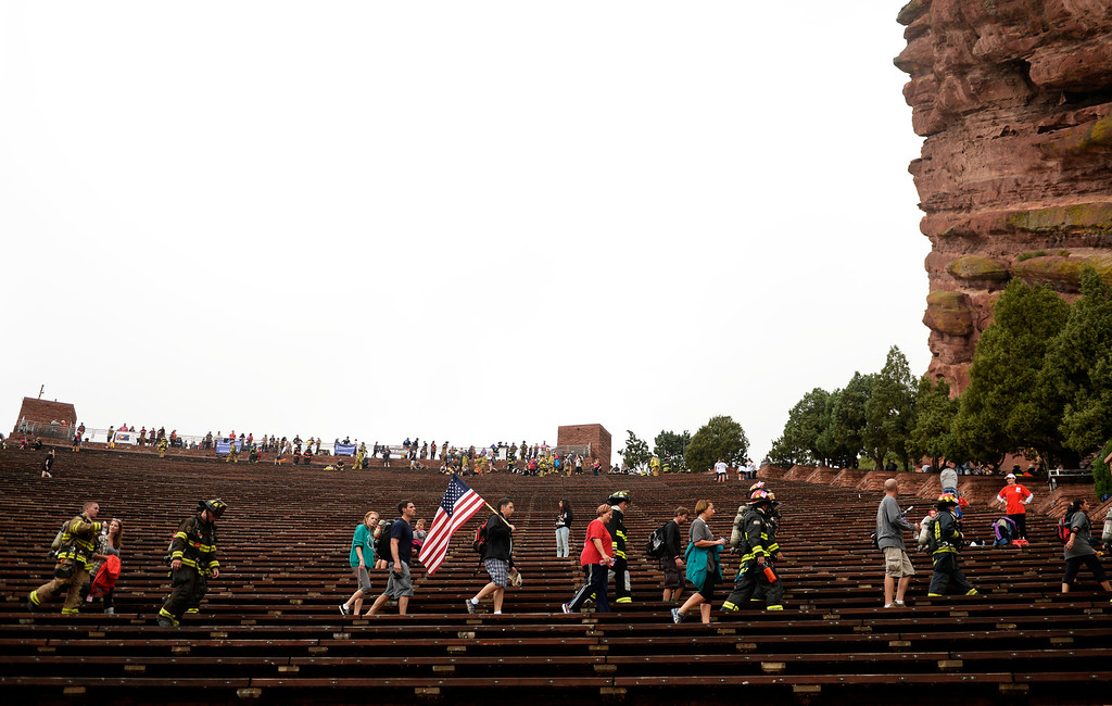 . Firefighters and community members gather at Red Rocks Amphitheater to honor the people and events of 9/11, September 11, 2013. (Photo By RJ Sangosti/The Denver Post)