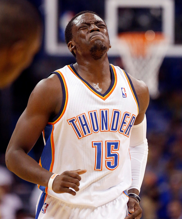 . Oklahoma City Thunder guard Reggie Jackson grimaces as he limps back up the court after a fall in the first quarter of Game 4 of the Western Conference finals NBA basketball playoff series against the San Antonio Spurs in Oklahoma City, Tuesday, May 27, 2014. (AP Photo/Sue Ogrocki)