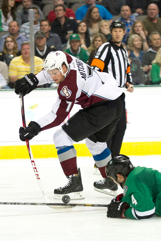 . DALLAS, TX - NOVEMBER 1:  John Mitchell #7 of the Colorado Avalanche has the puck knocked away by Jamie Benn #14 of the Dallas Stars on November 1, 2013 at the American Airlines Center in Dallas, Texas.  (Photo by Cooper Neill/Getty Images)