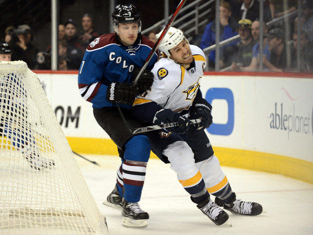 . John Mitchell of Colorado Avalanche (#7), left, checks Shea Weber of Nashville Predators (#6) in the 3rd period of the game at Pepsi Center. Denver, Colorado. March 30, 2013. (Photo By Hyoung Chang/The Denver Post)