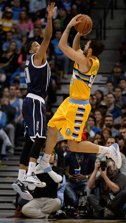 . Denver Nuggets shooting guard Evan Fournier (94) takes a shot over Oklahoma City Thunder shooting guard Andre Roberson (21) during the fourth quarter  January 9, 2014 at Pepsi Center. The Denver Nuggets defeated the Oklahoma City Thunder 101-88. (Photo by John Leyba/The Denver Post)