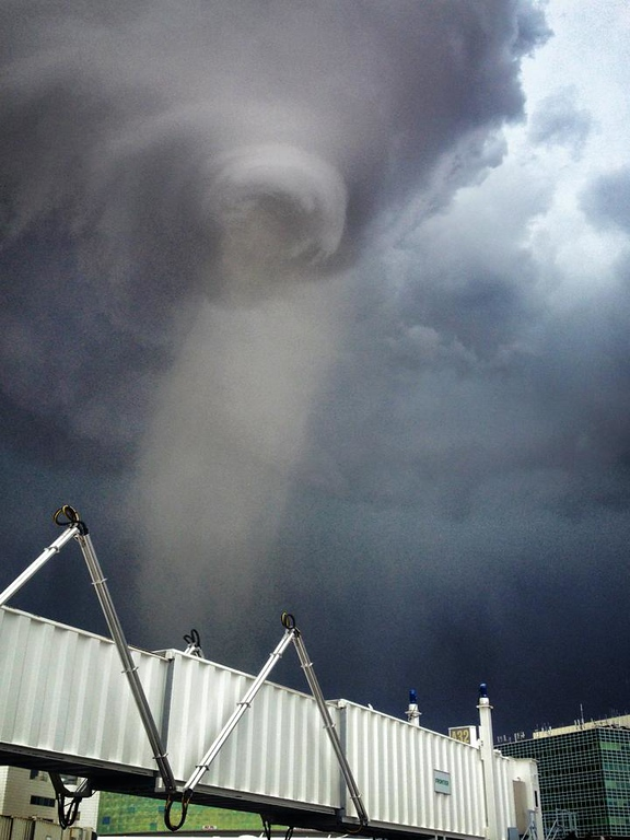 . The funnel of a tornado is seen from Denver International Airport. (Photo Courtesy of Mike Sellers)