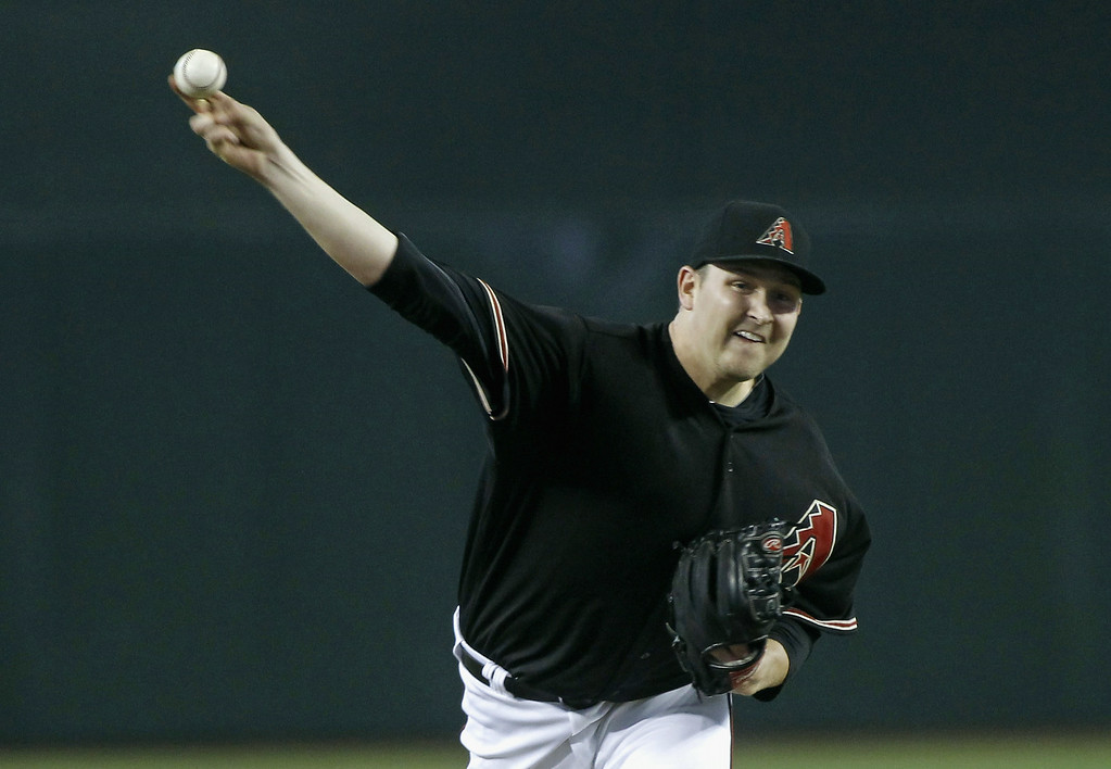 . Trevor Cahill #35 of the Arizona Diamondbacks delivers a pitch against the Colorado Rockies during the first inning of a MLB game at Chase Field on August 9, 2014 in Phoenix, Arizona.  (Photo by Ralph Freso/Getty Images)