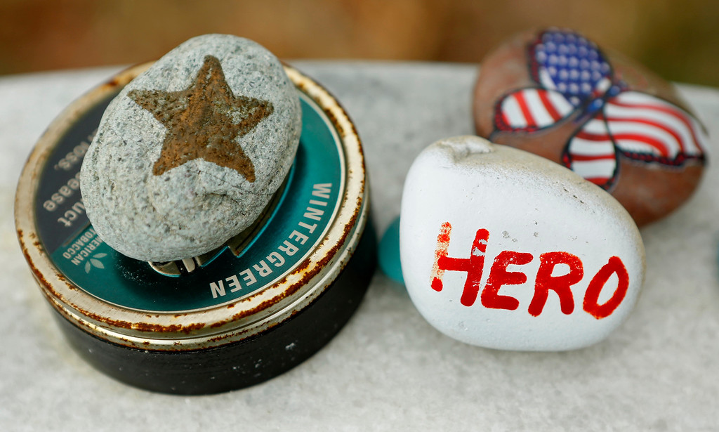 . Mementos are seen on a headstone in Section 60 at Arlington National Cemetery in Virginia, March 13, 2013. Section 60 contains graves of soldiers from the wars in Iraq and Afghanistan. Picture taken March 13, 2013. REUTERS/Kevin Lamarque