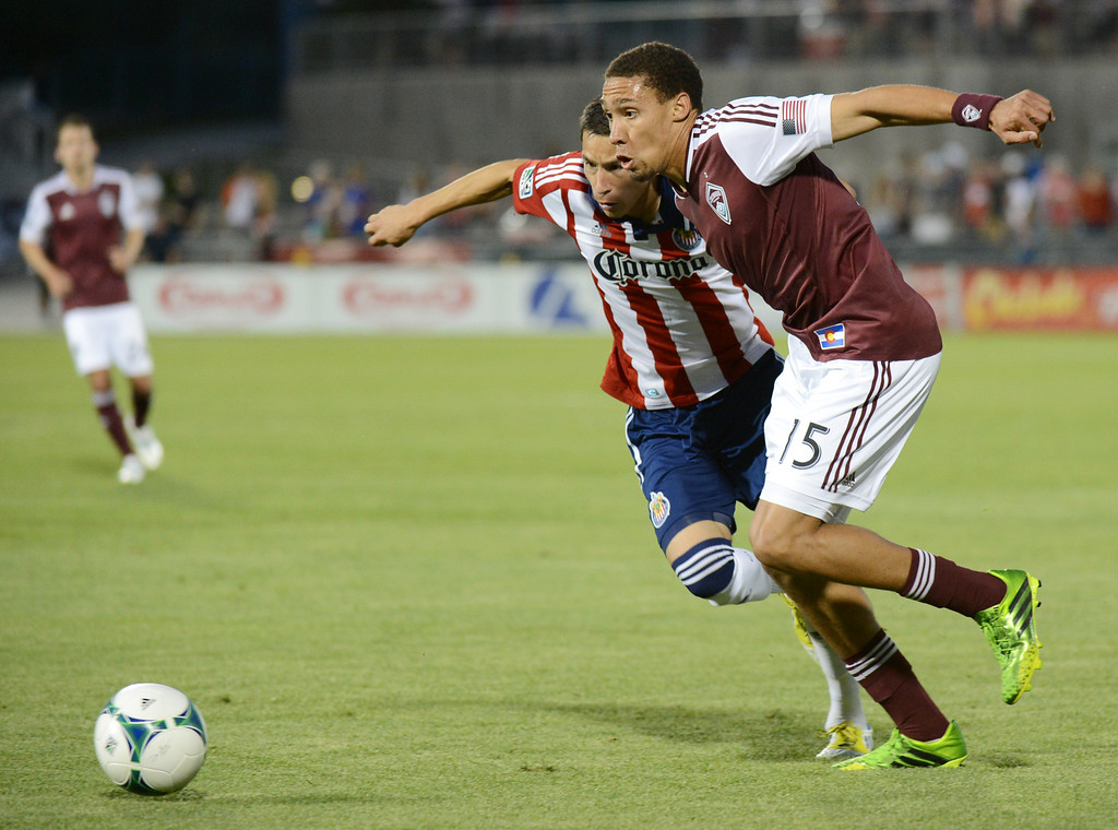 . COMMERCE CITY, CO. - MAY 25: Christopher Klute of Colorado Rapids (15) and Eric Avila of Chivas USA (15) are chasing the ball in the 2nd half of the game at Dick\'s Sporting Goods Park. Commerce City, Colorado. May 25, 2013. Colorado won 2-0. (Photo By Hyoung Chang/The Denver Post)