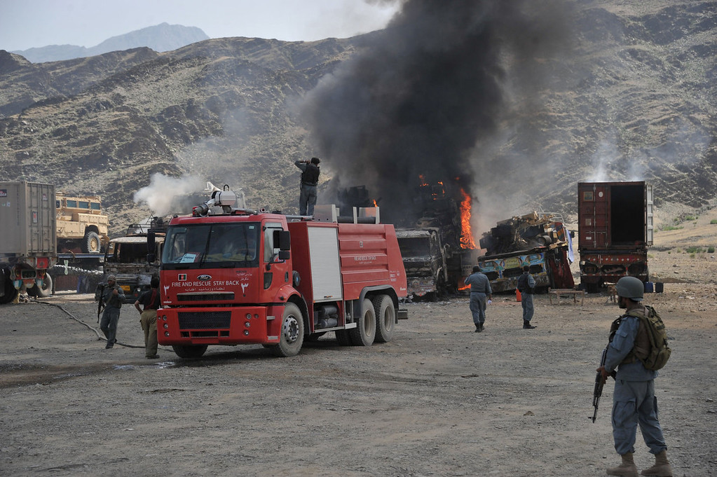 . Afghan security personnel stand alert near burnt military vehicles after a clash between Taliban and Afghan security forces in Torkham on September 2, 2013. A group of Taliban suicide bombers and gunmen attacked a US base near the Pakistani border in eastern Afghanistan, sparking a three-hour shootout, officials said. No member of the US-led NATO mission in Afghanistan was killed in the attack on a base in Nangarhar province, said a spokesman for the International Security Assistance Force (ISAF).   Noorullah Shirzada/AFP/Getty Images