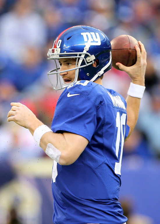 . Eli Manning #10 of the New York Giants passes the ball in the first quarter against the Oakland Raiders at MetLife Stadium on November 10, 2013 in East Rutherford, New Jersey.  (Photo by Elsa/Getty Images)