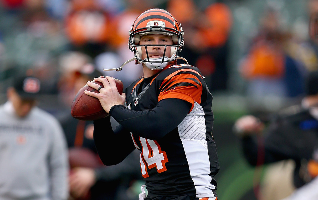 . Andy Dalton #14 of the Cincinnati Bengals throws a pass before the NFL wild card playoffs game against the San Diego Chargers at Paul Brown Stadium on January 5, 2014 in Cincinnati, Ohio.  (Photo by Andy Lyons/Getty Images)