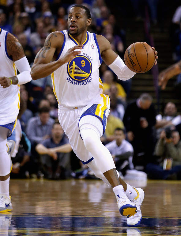 . Andre Iguodala #9 of the Golden State Warriors dribbles down court during their game against the Denver Nuggets at ORACLE Arena on January 15, 2014 in Oakland, California.  (Photo by Ezra Shaw/Getty Images)