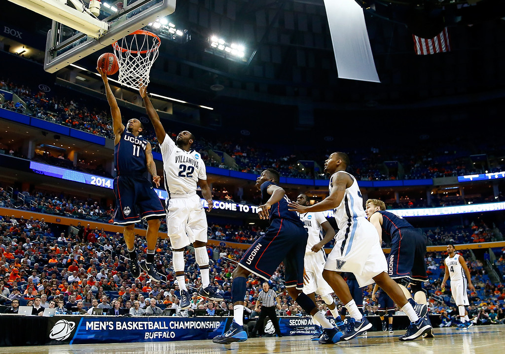 . BUFFALO, NY - MARCH 22: Ryan Boatright #11 of the Connecticut Huskies goes to the basket as JayVaughn Pinkston #22 of the Villanova Wildcats defends during the third round of the 2014 NCAA Men\'s Basketball Tournament at the First Niagara Center on March 22, 2014 in Buffalo, New York.  (Photo by Jared Wickerham/Getty Images)