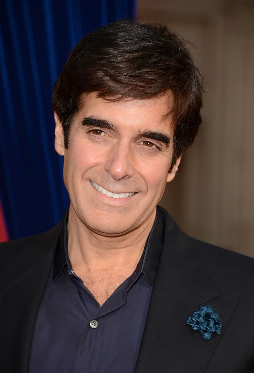 ". Illusionist David Copperfield attends the premiere of Warner Bros. Pictures\' ""The Incredible Burt Wonderstone\"" at TCL Chinese Theatre on March 11, 2013 in Hollywood, California.  (Photo by Jason Merritt/Getty Images)"