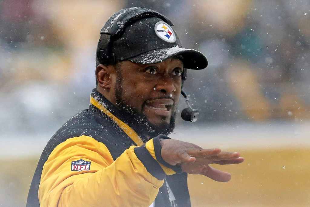 . Pittsburgh Steelers head coach Mike Tomlin gives instructions from the sidelines during the first half of an NFL football game against the Miami Dolphins in Pittsburgh, Sunday, Dec. 8, 2013. (AP Photo/Tom E. Puskar)