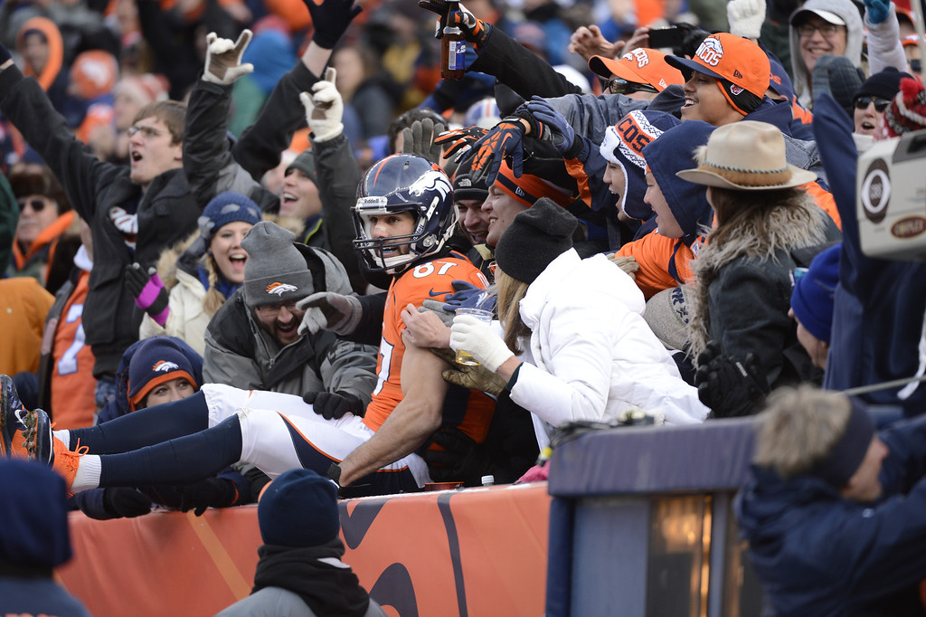. Denver Broncos wide receiver Eric Decker (87) jumps in the stands after scoring a touchdown as the Denver Broncos took on the Kansas City Chiefs at Sports Authority Field at Mile High in Denver, Colorado on December 30, 2012. Joe Amon, The Denver Post