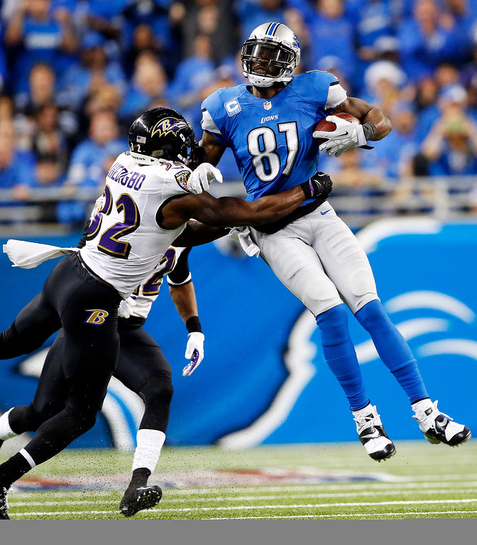 . Baltimore Ravens strong safety James Ihedigbo (32) tackles Detroit Lions wide receiver Calvin Johnson (81) during the third quarter of an NFL football game in Detroit, Monday, Dec. 16, 2013. (AP Photo/Paul Sancya)