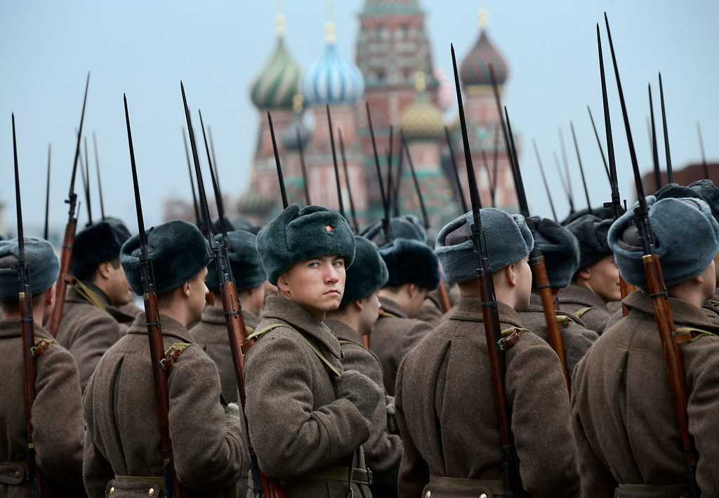 . Russian soldiers dressed in Red Army World War II uniforms prepare to parade in Red Square with St. Basil\'s Cathedral in the background in Moscow, Russia on Thursday, Nov. 7, 2013 to mark the 72nd anniversary of a historic World War II parade. (AP Photo/Alexander Zemlianichenko, File)