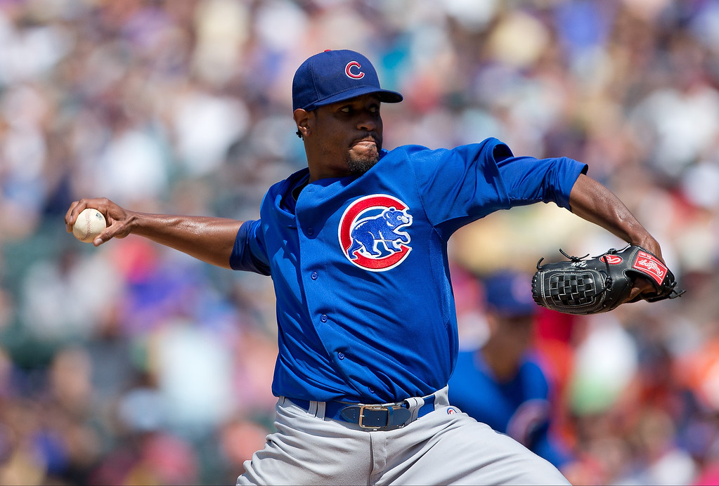 . Starting pitcher Edwin Jackson #36 of the Chicago Cubs delivers to home plate during the fourth inning against the Colorado Rockies at Coors Field on July 21, 2013 in Denver, Colorado. The Rockies defeated the Cubs 4-3.  (Photo by Justin Edmonds/Getty Images)