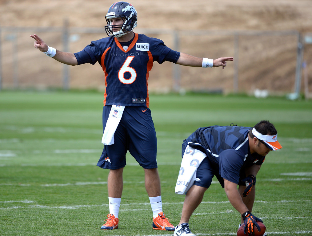 . QB Derek Thompson (6) runs through drills with fellow rookies as the Denver Broncos host their rookie minicamp at Dove Valley in Englewood on Friday, May 16, 2014.  (Kathryn Scott Osler, The Denver Post)