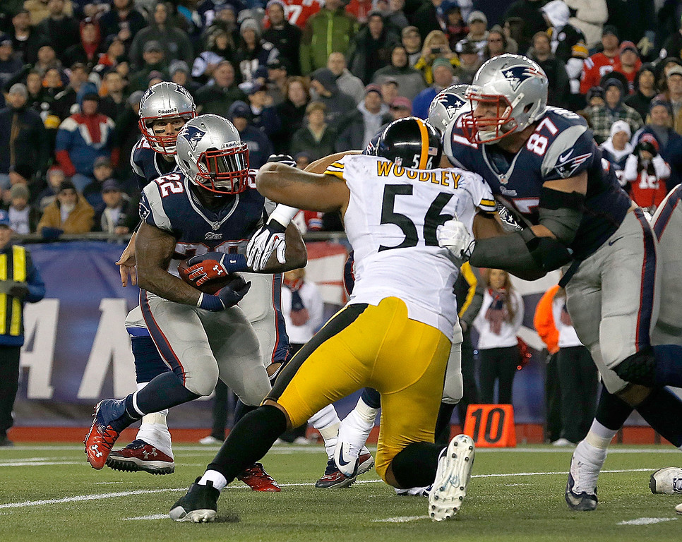 . Stevan Ridley #22 of the New England Patriots works his way by LaMarr Woodley #56 of the Pittsburgh Steelers for a touchdown in the 2nd quarter during a game at Gillette Stadium on November 3, 2013 in Foxboro, Massachusetts. (Photo by Jim Rogash/Getty Images)