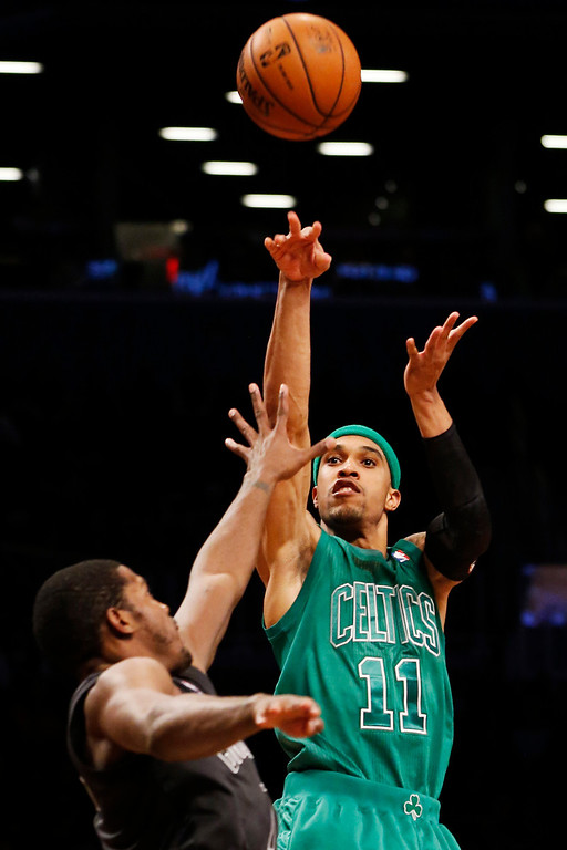 . Boston Celtics\' Courtney Lee (11) shoots over Brooklyn Nets guard Joe Johnson (7) in the second half of their NBA basketball game at Barclays Center, Tuesday, Dec. 25, 2012, in New York. Boston won 93-76. (AP Photo/John Minchillo)