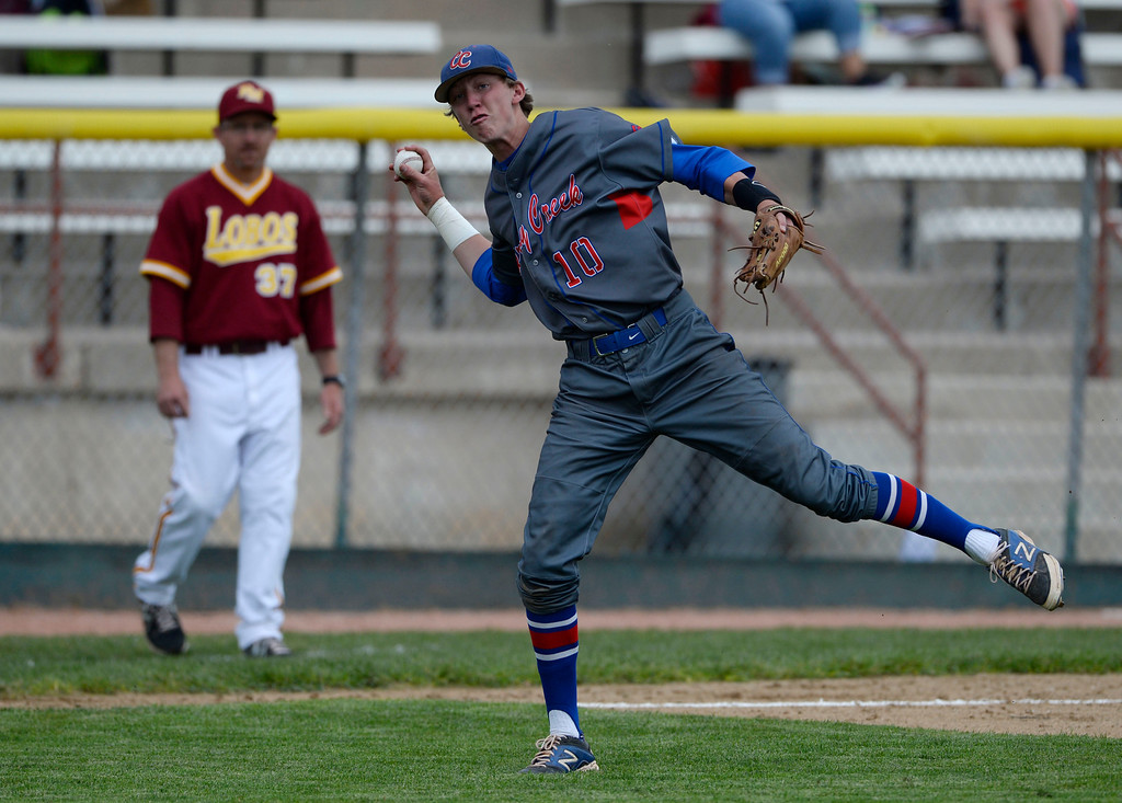 . DENVER, CO. - MAY 23: Cherry Creek infielder, Kyle Reisman, picks up a dribbler an throws out Cole Anderson at first in the second inning during the Colorado State 5A baseball playoffs at All City Field Friday afternoon, May 23, 2014. (Photo By Andy Cross / The Denver Post)