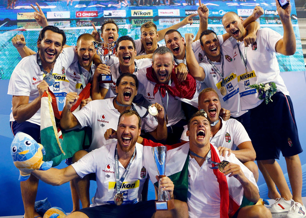 . Hungary\'s team celebrate with the trophy after winning against Montenegro at their men\'s water polo gold medal match during the World Swimming Championships at the Piscines Bernat Picornell in Barcelona August 3, 2013.  REUTERS/Michael Dalder