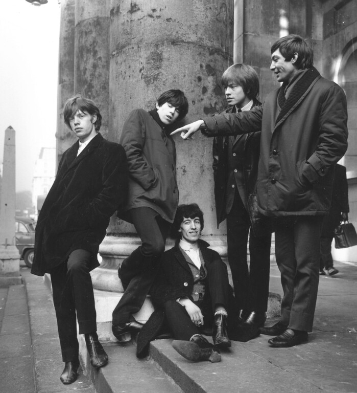 . Members of the pop group The Rolling Stones on the steps of St George\'s Hanover Square, from left to right; Mick Jagger, Keith Richards, Bill Wyman (sitting), Brian Jones (1942 - 1969) and Charlie Watts, January 17, 1964.  (Photo by Terry Disney/Express/Getty Images)