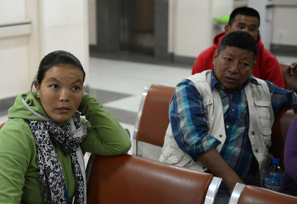 . Fhurbu Sherpa (L), wife of Nepalese mountaineer Dawa Tashi Sherpa who survived an avalanche on Mount Everest, talks to a journalist as she waits at the Grandi International Hospital in Kathmandu on April 18, 2014.  At least 12 Nepalese guides preparing routes up Mount Everest for commercial climbers were killed by an avalanche in the most deadly mountaineering accident ever on the world\'s highest peak, officials and rescuers say.The men were among a large party of Sherpas carrying tents, food and ropes who headed out in bright sunshine in an early morning expedition ahead of the main climbing season starting later this month. PRAKASH MATHEMA/AFP/Getty Images