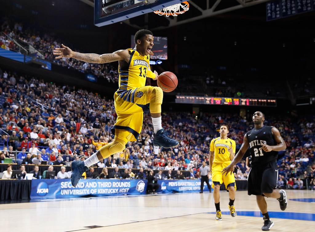 . LEXINGTON, KY - MARCH 23:  Vander Blue #13 of the Marquette Golden Eagles reacts after stealing the ball and a dunk against the Butler Bulldogs in the second half during the third round of the 2013 NCAA Men\'s Basketball Tournament at Rupp Arena on March 23, 2013 in Lexington, Kentucky.  (Photo by Kevin C. Cox/Getty Images)