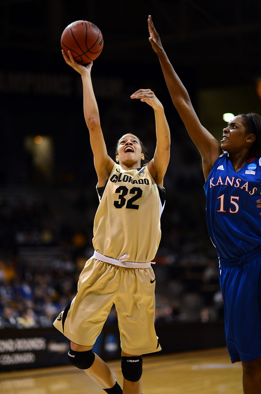 . BOULDER, CO. - MARCH 23: Arielle Roberson of Colorado Buffaloes (32), drives for the basket against Chelsea Gardner of Kansas Jayhawks (15) during the first round of the 2013 NCAA women\'s Basketball Tournament at Coors Events Center. Boulder, Colorado. March 23, 2013. (Photo By Hyoung Chang/The Denver Post)