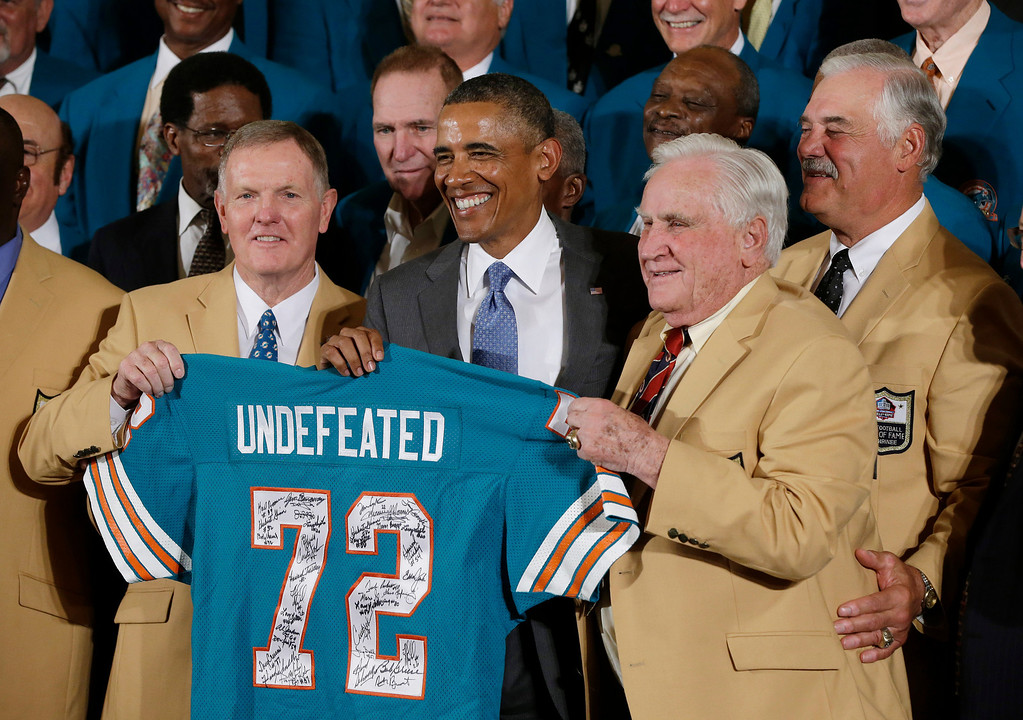 . Former Miami Dolphins football quarterback Bob Griese, left, and Hall of Fame Dolphins Coach Don Shula, second from right, and Larry Csonka, right, pose for photographs with a signed team jersey during a ceremony in the East Room of the White House in Washington, Tuesday, Aug. 20, 2013, where the president honored the Super Bowl VII football Champion Miami Dolphins. The 1972 Miami Dolphins remain the only undefeated team in NFL history. (AP Photo/Pablo Martinez Monsivais)