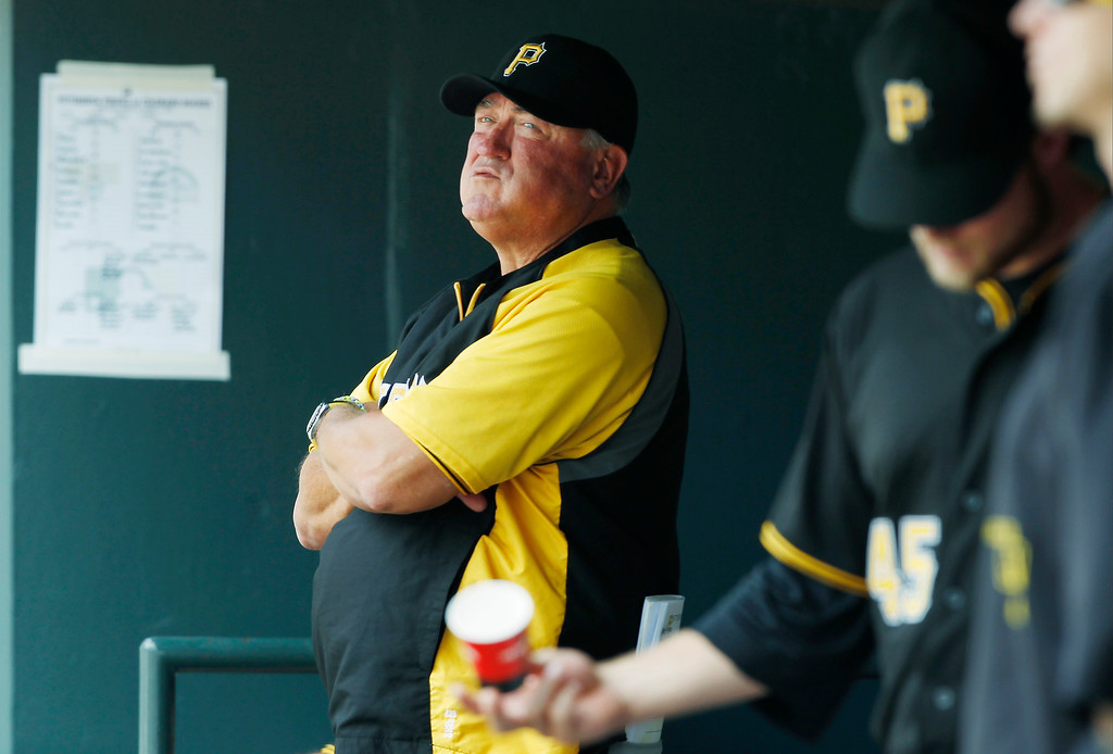 . Pittsburgh Pirates manager Clint Hurdle looks on against the Colorado Rockies in the first inning a baseball game in Denver on Sunday, Aug. 11, 2013. (AP Photo/David Zalubowski)