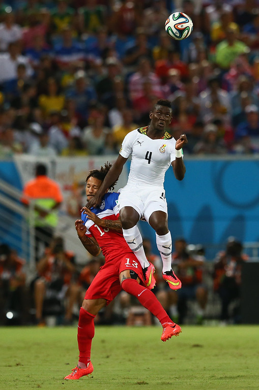 . Daniel Opare of Ghana goes up for a header against Jermaine Jones of the United States during the 2014 FIFA World Cup Brazil Group G match between Ghana and the United States at Estadio das Dunas on June 16, 2014 in Natal, Brazil.  (Photo by Kevin C. Cox/Getty Images)