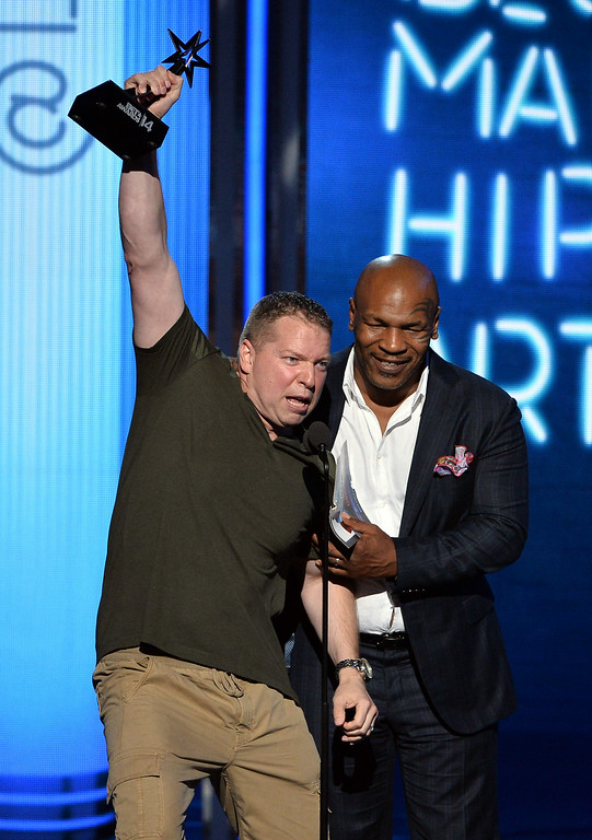 . Actor Gary Owen (L) and former boxer Mike Tyson speak onstage during the BET AWARDS \'14 at Nokia Theatre L.A. LIVE on June 29, 2014 in Los Angeles, California.  (Photo by Kevin Winter/Getty Images for BET)