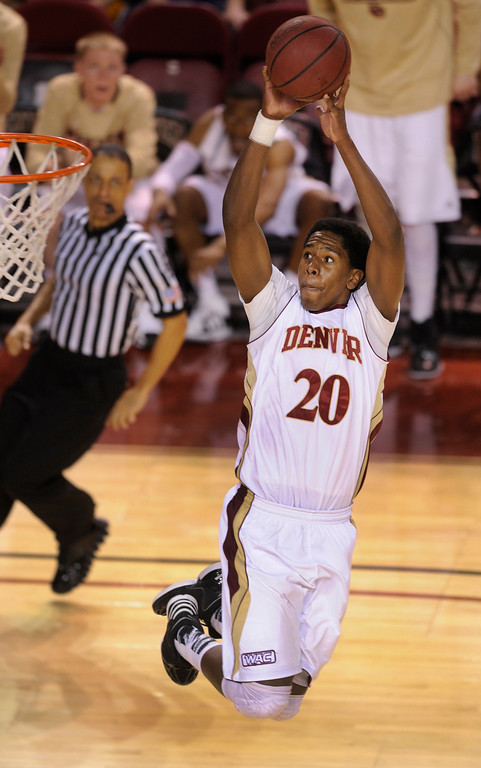 . DENVER, CO. - MARCH 2: Pioneers sophomore forward Royce O\'Neale (20) flew through the air on the way to the basket in the second half. The University of Denver men\'s basketball team defeated New Mexico State 66-60 Saturday evening, March 2, 2013 at Magness Arena. (Photo By Karl Gehring/The Denver Post)