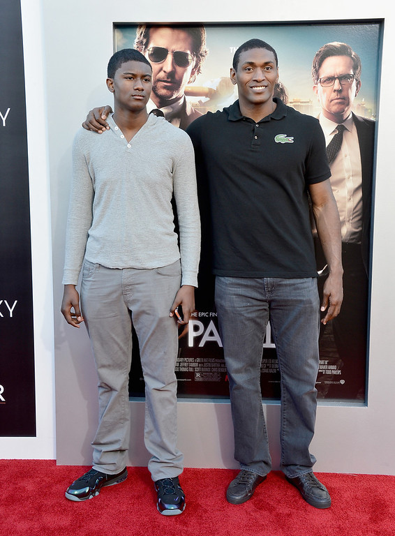 """. NBA player Metta World Peace (R) and his son attend the premiere of Warner Bros. Pictures\' \""""Hangover Part 3\"""" at Westwood Village Theater on May 20, 2013 in Westwood, California.  (Photo by Frazer Harrison/Getty Images)"""