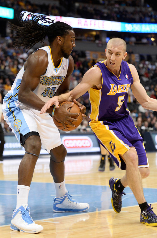 . DENVER, CO - NOVEMBER 13: Los Angeles Lakers point guard Steve Blake (5) reaches in on Denver Nuggets power forward Kenneth Faried (35) during the first quarter November 13, 2013 at Pepsi Center. (Photo by John Leyba/The Denver Post)
