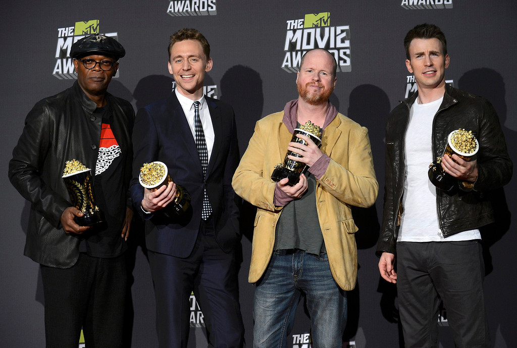 ". Director Joss Whedon (2nd from R) and cast members Samuel L. Jackson (L), Tom Hiddleston and Chris Evans (R) pose with their awards for movie of the year for ""The Avengers\"" backstage at the 2013 MTV Movie Awards in Culver City, California April 14, 2013.   REUTERS/Phil McCarten"