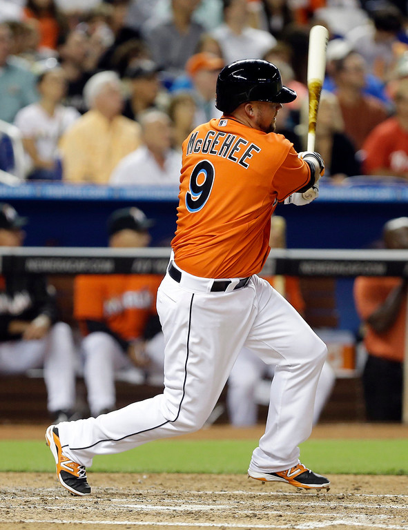 . Miami Marlins\' Casey McGehee (9) hits a double to score three runs during the fifth inning of an opening day baseball game against the Colorado Rockies, Monday, March 31, 2014, in Miami. (AP Photo/Lynne Sladky)