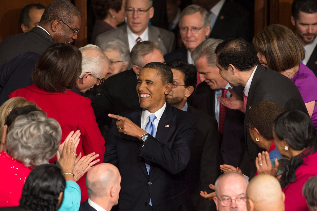 . US President Barack Obama (C) arrives to deliver his State of the Union address before a joint session of Congress, on Capitol Hill in Washington DC, USA, 28 January 2014.  EPA/MICHAEL REYNOLDS