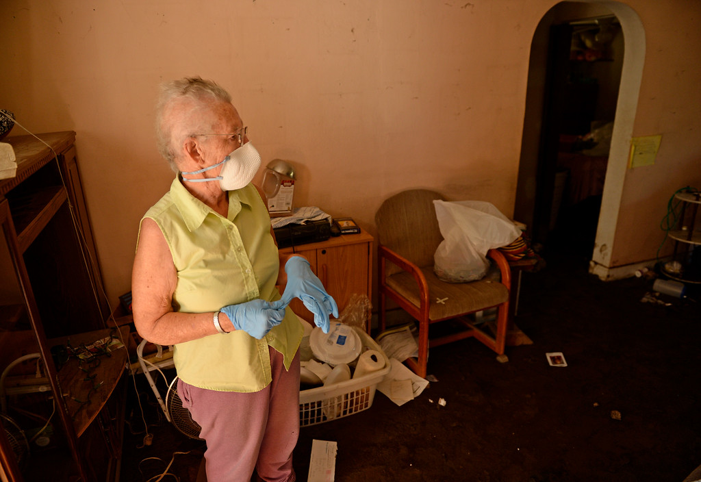 . Avis Livingston, 65, who has lived in the Lyons area her whole life, tries to save some of her belongings that were destroyed in the flood in Lyons, September 20, 2013. Residents start to clean up after a massive flood hit the area. (Photo By RJ Sangosti/The Denver Post)
