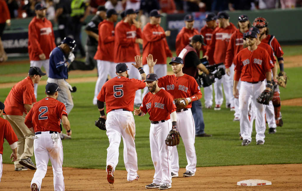 . The Boston Red Sox celebrate their 12-2 win over the Tampa Bay Rays in Game 1 of baseball\'s American League division series, Friday, Oct. 4, 2013, in Boston. (AP Photo/Stephan Savoia)