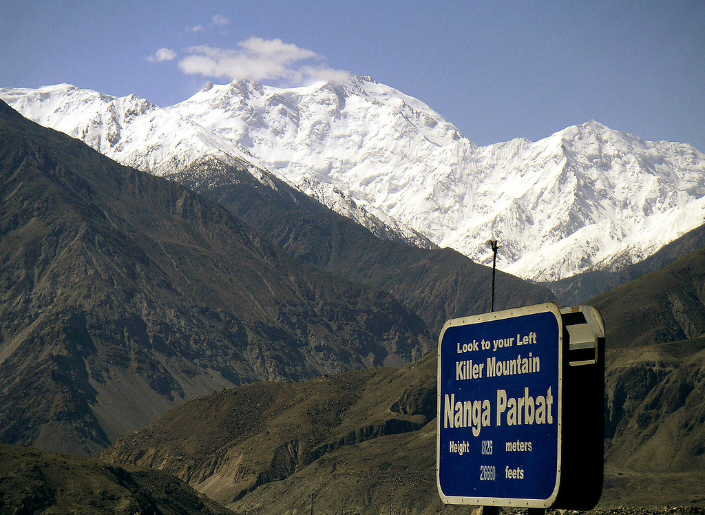 . Nanga Parbat, the ninth highest mountain in the world, is seen from Karakorum Highway leading to neighboring China in Pakistan\'s northern area in 2004. Gunmen wearing police uniforms killed nine foreign tourists and one Pakistani before dawn Sunday, June 23, 2013 as they were visiting one of the world\'s highest mountains in a remote area of northern Pakistan, officials said. (AP Photo/Musaf Zaman Kazmi, File)