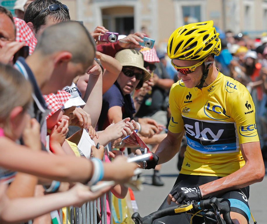 . Christopher Froome of Britain, wearing the overall leader\'s yellow jersey, signs autographs prior to the tenth stage of the Tour de France cycling race over 197 kilometers (123.1 miles) with start in in Saint-Gildas-des-Bois and finish in Saint-Malo, Brittany region,  western France, Tuesday July 9 2013. (AP Photo/Christophe Ena)