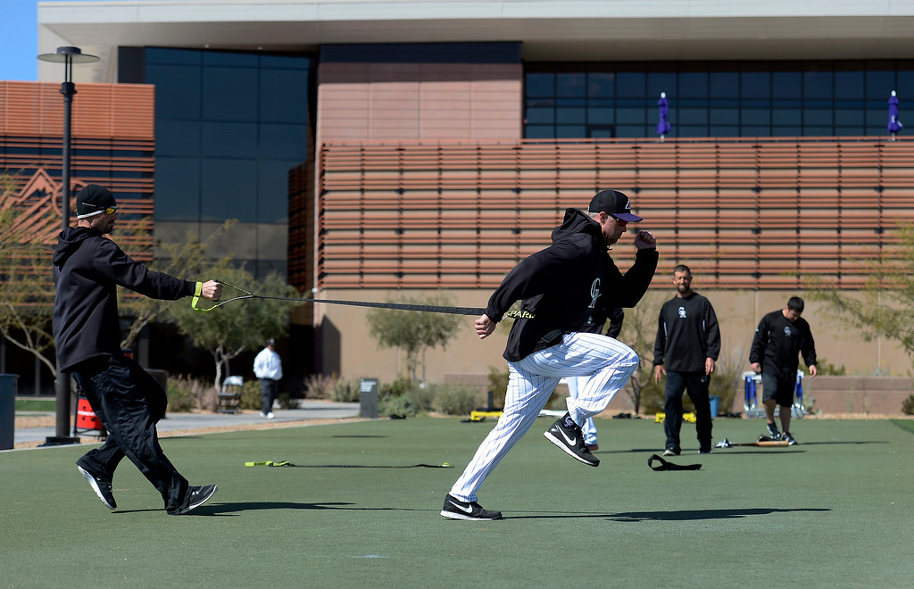 . SCOTTSDALE, AZ. - FEBRUARY 24: Michael Cuddyer (3) of the Colorado Rockies gets in conditioning work before their game against the Arizona Diamondbacks February 24, 2013 in Scottsdale. (Photo By John Leyba/The Denver Post)