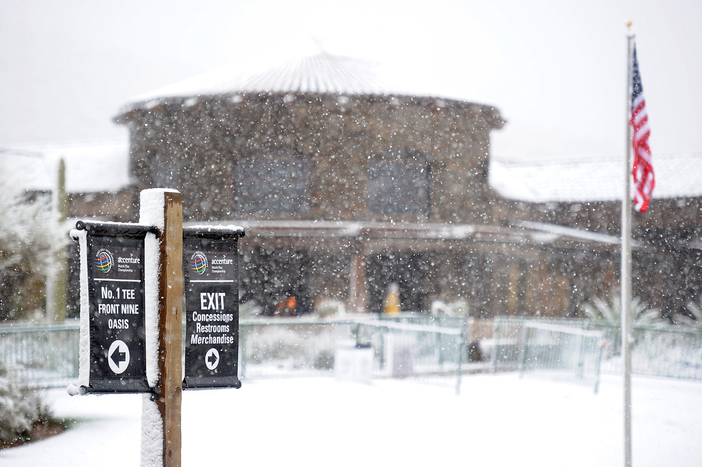 . MARANA, AZ - FEBRUARY 20:  Snow covers the clubhouse behind the 18th green during the first round of the World Golf Championships - Accenture Match Play at the Golf Club at Dove Mountain on February 20, 2013 in Marana, Arizona.  (Photo by Stuart Franklin/Getty Images)