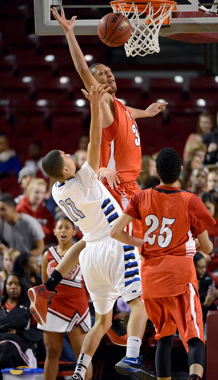 . DENVER, CO. - FEBRUARY 09: Tyre Robinson (32) of East goes up high to block a shot by Isaiah Parros (11) of Highlands Ranch February 9, 2012 at Magness Arena.  East defeated Highlands Ranch 73 - 54. (Photo By John Leyba/The Denver Post)